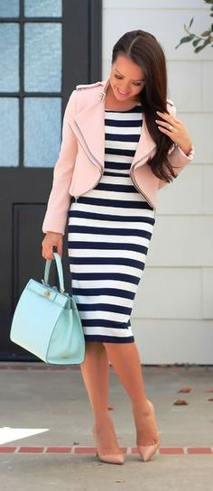 Street fashion striped dress and pastel pink leather jacket