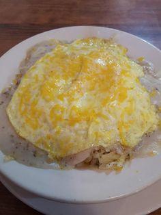 Breakfast bowl: biscuit, hash browns, egg, cheese, sausage gravy.
