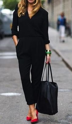 Street fashion black jumpsuit and red pumps.