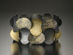 Bracelet | Beth Solomon. Oxidized silver, 18k gold, sterling silver fused with 18 and 22k recycled gold.