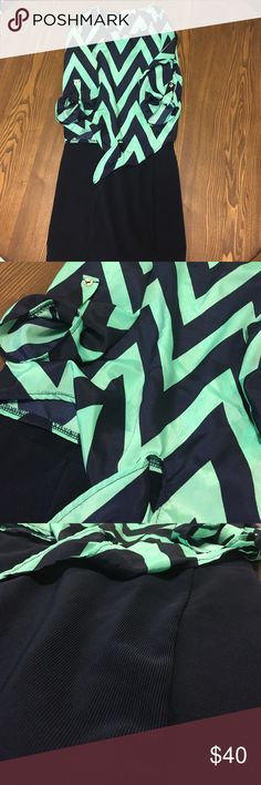 ❗️FINAL PRICE DROP❗️SELLING AS BUNDLE Navy and Green chevron crop top. Tie at the bottom of shirt. Navy Forever 21 skirt. Both in perfect condition. No stains. No flaws. Shirt size small. Skirt size medium Forever 21 Tops Crop Tops