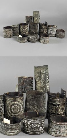 Papua New Guinea ~ Kilenge and Mandok | Collection of turtle armbands; with incised geometric decoration and lime filled, two with pierced decoration of fish and birds, the largest 13.2cm long | 1'500£ ~ sold (Feb '15)