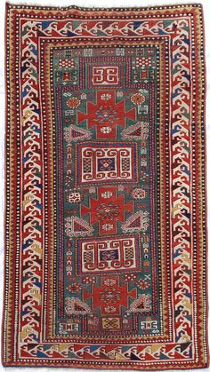 Karachop or Karachov Type B Rug / circa 1875-1900 Rare beautiful rug has geometric polychrome dragon borders, green abrash field, beautiful bright red, saffron and blue tones. Red weft. In very nice condition with no tears, staining or wear spots. 90 in. long x 52 in. wide.  Perhaps the best one of these I've seen!