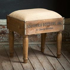 This beautifully crafted vintage inspired foot stool is made from wooden crates. Each wooden foot stool features a soft cushion and a distinctive appearance to add rustic charm to any space! For more visit, Decor Steals. - Decor Home Wooden Furniture Legs, Vintage Industrial Furniture, Recycled Furniture, Rustic Furniture, Diy Furniture, Automotive Furniture, Automotive Decor, Furniture Design, Plywood Furniture