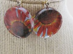 Red Rust Sunflower Earrings by RadiantRogueStars on Etsy, $13.00