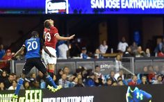 Shaun Francis (L) of the San Jose Earthquakes competes for the ball with James Wilson (R) of Manchester United during their International Champions Cup football match
