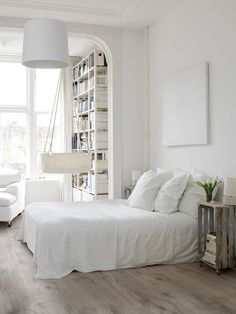 Wooden floors and white sheets