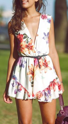 Summer fashion   Floral romper with tiny belt and handbag