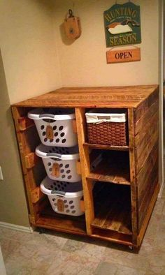 PALLET LAUNDRY BASKET HOLDER...with Shelves! Such a great idea! Would you like to have one of these? Featured on our Best DIY Family Organization Ideas!  http://kitchenfunwithmy3sons.com/2016/02/the-best-diy-home-tips-and-organizing-hacks-and-tips.html/