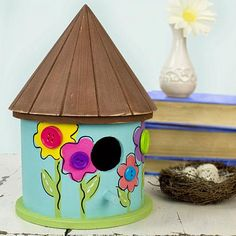 Cute As A Button Flower Birdhouse -- Add color, texture, and interest to a wooden birdhouse.