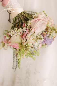 garden roses, wax flowers, greens in (light pinks and whites)