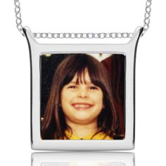 Print a tile of each of your children, swich out day to day. Custom jewelry