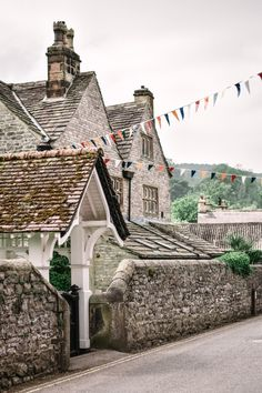 Ashford-In-The-Water is one of the prettiest villages in the Peak District, Derbyshire. Set next to a babbling brook, this ancient village is a must see for anyone visiting the area. Here is my quick guide to this picture postcard village. Cornwall England, Yorkshire England, London England, Oxford England, Yorkshire Dales, Peak District England, Irish Cottage, Holiday Places, Scenic Photography