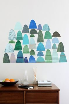 Skyline Rhythm  Dimensions: Various  Pieces: 34  Bring the Rex Ray sleek, yet playful aesthetic home with this wall decal inspired by Ray's handmade, hand-painted collages and printed papers. Create your own signature Rex Ray piece with the intricate fingerprints of Skyline Rhythm.  $45.00
