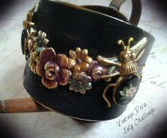 Vintage Diva July Challenge piece using the Floral Swag, porcelain floral cameo and the little beetle bugs, the cuff is from my stash.