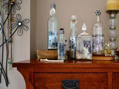 Instead of typical picture frames, display your favorite photos inside unusual-shaped bottles. Place tiny shells, decorative sand or beads in the bottom of each bottle. Roll up the photo to stick it inside the bottle. Then seal the bottle with a decorative cork and some pretty trinkets. Get the step-by-step instructions >>