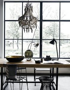 A lesson in composition. I love the kitchen table and bowl. The chandelier isn't my taste, but it's composed beautifully in the space.