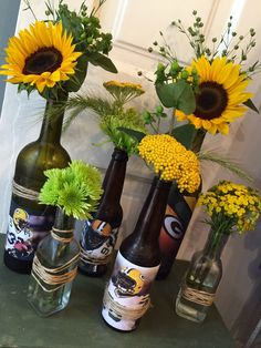 Packer football centerpiece in upcycled beer and wine bottles.