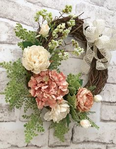Lovely Spring Wreath, Silk Floral Wreath, Grapevine Wreath, Summer Wreath, Wedding Wreath, Anniversary Wreath, Mothers Day Wreath, Wreath on Etsy -    This lovely floral wreath was handmade using a grapevine wreath base adorned with gorgeous peach and ivory burlap and silk flowers, beautiful greenery, and a swirling ivory bow. This would be stunning displayed on your interior wall, mirror, mantel, or front door. Its perfect for Spring, Summer, an anniversary, bridal shower, wedding, Mothers…