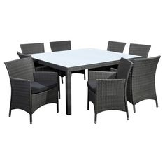 Indoor-outdoor dining set featuring 8 woven wicker-inspired arm chairs and a complementing table.   Product: Dining table and 8 ...