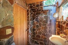 Stone shower -- Tropical Tiny House in California