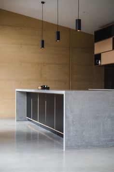 black pendants, concrete island bench with slab ends