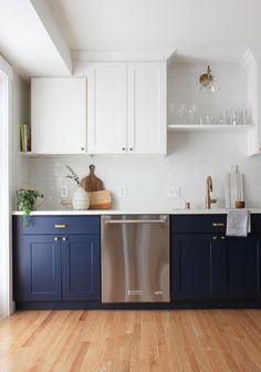 7 Money-Saving Lessons I've Learned from Renovating Homes - Update Your Kitchen Cabinets Cheap Kitchen Cabinets, Kitchen Reno, New Kitchen, Kitchen Dining, Blue Cabinets, Hardwood In Kitchen, Kitchen Plinth, Stock Cabinets, Budget Kitchen Remodel