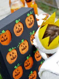 Cora's idea: each pumpkin is a litle swinging door/flap; behind each flap is 1 or 2 candies/prizes; one ticket = one pumpkin surprise