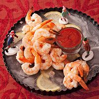 """""""Holiday Shrimp on Ice"""" - Rachael Ray  tip - Fill 9 or 10-inch tart pan or pie dish half full with water. Add a few lemon slices and place flat in freezer. Freeze until firm, at least 4 hours. Top with cooked shrimp and small bowl of cocktail sauce."""