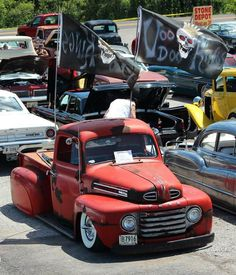 Ford F1 rat rod pickup truck with sweet fender skirts and rocking some custom club flags!