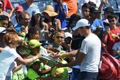 Fans flock to Milos Raonic after his practice in the Louis Armstrong Stadium…