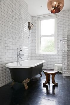 Love the black bath, the subway tiles and the copper light pendant salle de bain bathroom White Bathroom, Bathroom Interior, Small Bathroom, Bathroom Green, Bathroom Ideas, Copper Bathroom, Family Bathroom, Modern Bathroom, Bad Inspiration