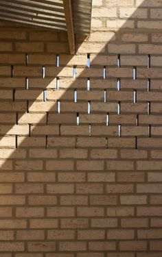 School for El Coporito | Antonio Peña + Juan Garay + Alexis Ávila—Estado de México, México. Subtle spaces between bricks at mid-height allows a glance at the other side.