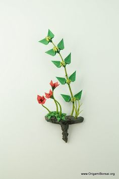 Origami Ikebana with Yellow and Red Flowers on Rock by Benagami