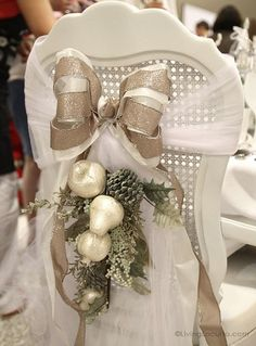 Christmas DIY Holiday Chair ~ Turn your dinning room chairs into fabulous decorations with a few yards of tulle fabric, ribbon, pretty flowers and glittered fruit.  Very pretty to put on the wedding couple's chairs.