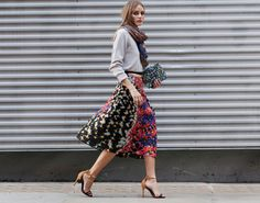 Olivia Palermo in a sweater from Skin and Threads with a colorful Peter Pilotto skirt, Schutz heels, a CH Carolina Herrera scarf and a clutch by Nathalie Trad.