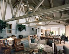 The exposed support beams add so much dimension to this great room. #homeinspiration #rafters