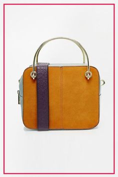 The Easiest Way To Update Your Wardrobe? A New Bag For Fall #refinery29  http://www.refinery29.com/new-fall-handbag-trends-2015#slide-4  A fresh take on colorblocking....