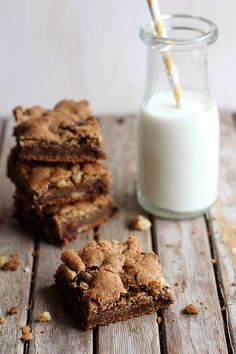 These are HANDS DOWN THE BEST CHOCOLATE COOKIES I HAVE HAD EVER!!!  Whole Wheat Chocolate Chip Cookie Bars by Completely Delicious, via Flickr
