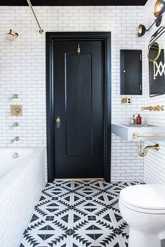 Black and white bathroom with brass accents