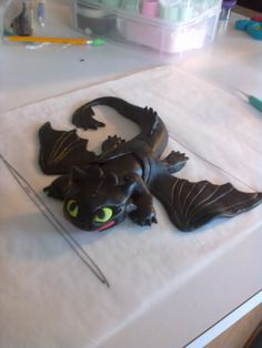 How cute! Its Toothless from How to Train Your Dragon.