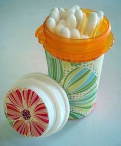 DIY Tutorial - recycle Medicine Bottles into a Q-tip Storage Container using scrapbook paper and Mod Podge. Would be great to throw in suitcase or purse for travel... could also store safety pins, bobby pins, etc.