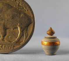 Jeff Spera - tuned lidded vessel, made from African Wonderstone and gilded with pure copper leaf, sold on ebay for $24