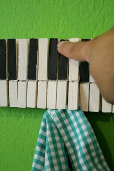Craft diy time. Take plain cloth pins and paint (or sharpie them in) hook and you have a clippy piano.   G;)