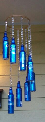 Yard Art Ideas Wind Chimes Bottle Caps 58 Trendy Ideas Yard Art Ideas Wind Chimes B Beer Bottle Crafts, Diy Bottle, Sun Catchers, Outdoor Chandelier, Chandelier Ideas, Bottle Chandelier, Diy Wind Chimes, Wine Bottle Art, Blue Bottle