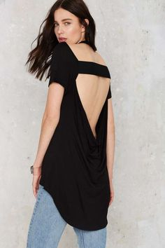 The Skin Deep Tee is black and features a crew neck, cutaway detail at right shoulder, elastic band and low cowl neck at back and a slouchy fit.