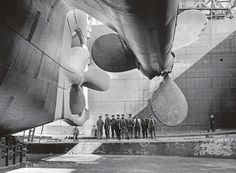 The propellers of the Olympic—the nearly identical sister ship of the Titanic—dwarf workers at the Belfast shipyard where both ocean liners were built. Few photographs exist of the Titanic, but the Olympic gives a sense of its grand design.