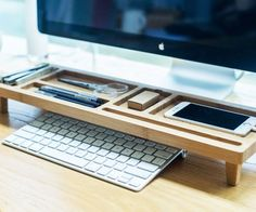 Keep your work space organized with this desktop wooden keyboard rack. It's handcrafted from sturdy bamboo and designed with various differently shaped compartments so that you can neatly accommodate anything lying around.