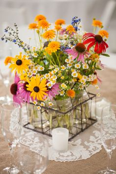 Colorful rustic centerpiece- flowers, mason jars and burlap. @wrenphotography