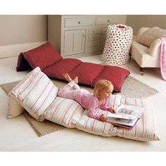 DIY Take-A-Long Bed! Take 5 pillowcases, sew them together and then put pillows in them. Next gift for my nieces for sure!!